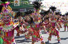 Bacolod City's Masskara Festival is a parade with street dancers wearing beautifully and intricately designed smiling masks and colorful costumes.